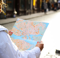 Tourist looking at City map outdoors