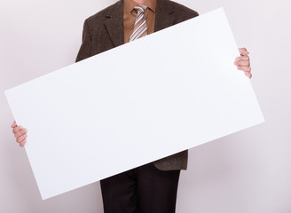 Businessman holding blank billboard. Advertising.
