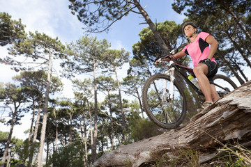 Woman with mountain bike in woods