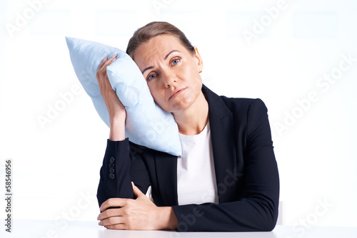 Businesswoman with pillow
