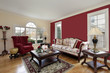 Living room with red and cream colored walls