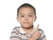 Little boy in round spectacles raising finger
