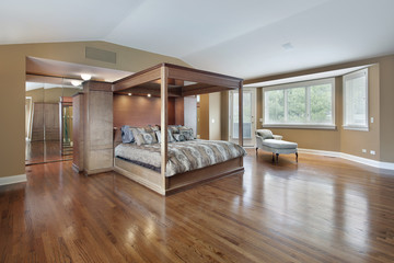Master bedroom with wood framed bed