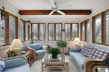 Sunroom with wood ceiling beam