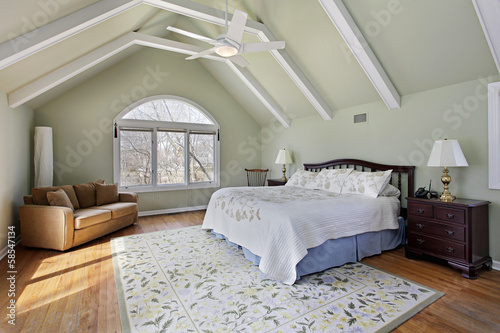 Master bedroom with ceiling beams