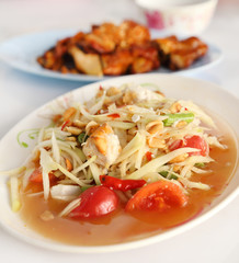 spicy papaya salad and roasting chicken