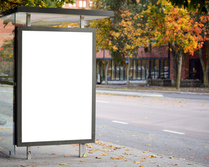 Blank billboard on city bus station
