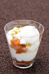dessert with peaches, whipped cream, meringue and pistachios
