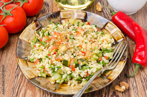 salad with bulgur, zucchini, tomatoes, parsley on the plate