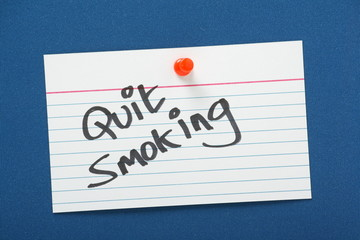 Quit Smoking reminder on a blue notice board