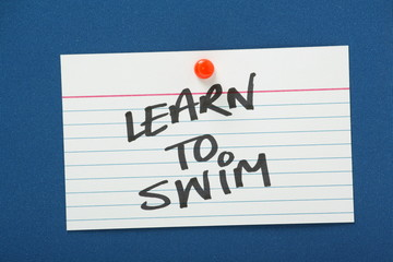 Reminder to Learn to Swim on a blue notice board