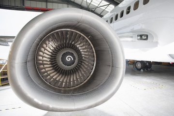 Engine on passenger jet in hangar