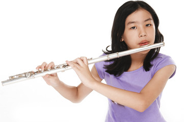 cute girl playing transverse flute on white background