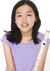 Portrait of a cute girl holding a flute