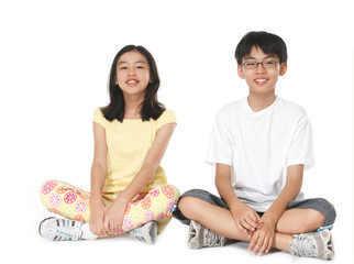 Portrait of teenagers sitting floor on white background