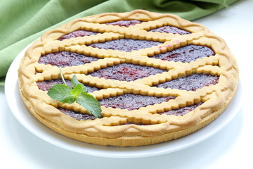 homemade cherry tart of shortcake dough with jam
