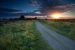 sunrise sunbeams over ground road