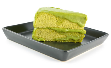 Green tea cake on white background