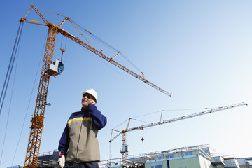 construction worker with cranes and builders