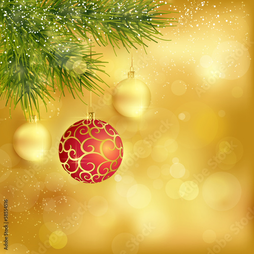 Golden Christmas background with baubles and fir twigs