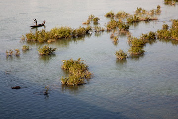 Fisher man working in their boat on the Niger River