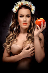 Beautiful woman with red apple, conceptual photo