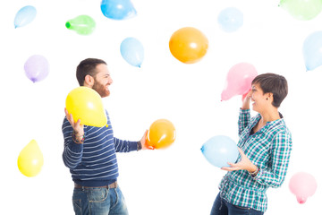 Friends at Party Playing with Colorful Baloons