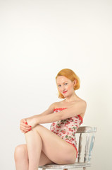 Red head sitting on chair