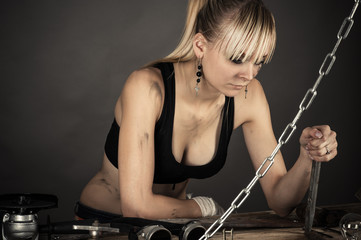 working woman looks at chisel