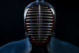 Front view of kendo helmet over black background, studio shot