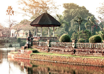 Bali.Traditional pavilion in park over the lake