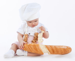 little baker breaking off piece of bread