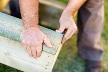 Manual Worker's Hand Fixing Wood At Site