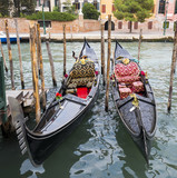 Two Gondolas in the Venice Channels in Italy