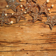 Golden stars, perls and wood background