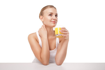 Young woman with a glass of orange juice isolated