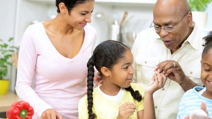 Little Ethnic Girls Helping Kitchen Mother Grandparents