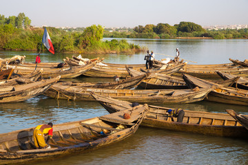 fisher men working in their boat on the Niger River