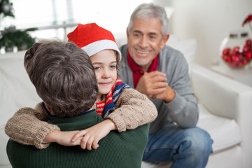 Son In Santa Hat Embracing Father