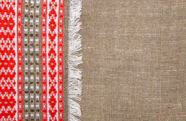 Burlap background bordered by country cloth