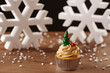 Xmas tree cupcake on Christmas background