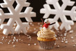 Snowman cupcake on Christmas background