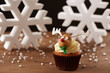 Rudolph reindeer cupcake on Christmas background