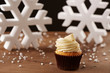 White chocolate cupcake on Christmas background