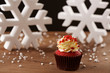 Red velvet cupcake on Christmas background
