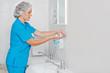 Leinwanddruck Bild - Beautiful nurse wiped his hands dry