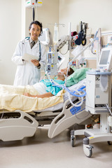 Doctor With Digital Tablet Examining Patient's Report