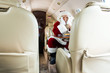 Santa Sitting In Private Jet