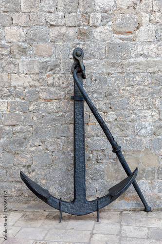 Ships' black painted anchor set on display