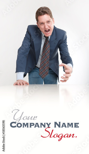 Angry businessman leaning on a desk
